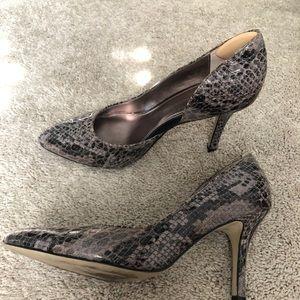 Anne Klein 4 in snake heels.